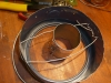 Weave Heavy Gauge Wire Through the Lid Holes Securing The Vent Form